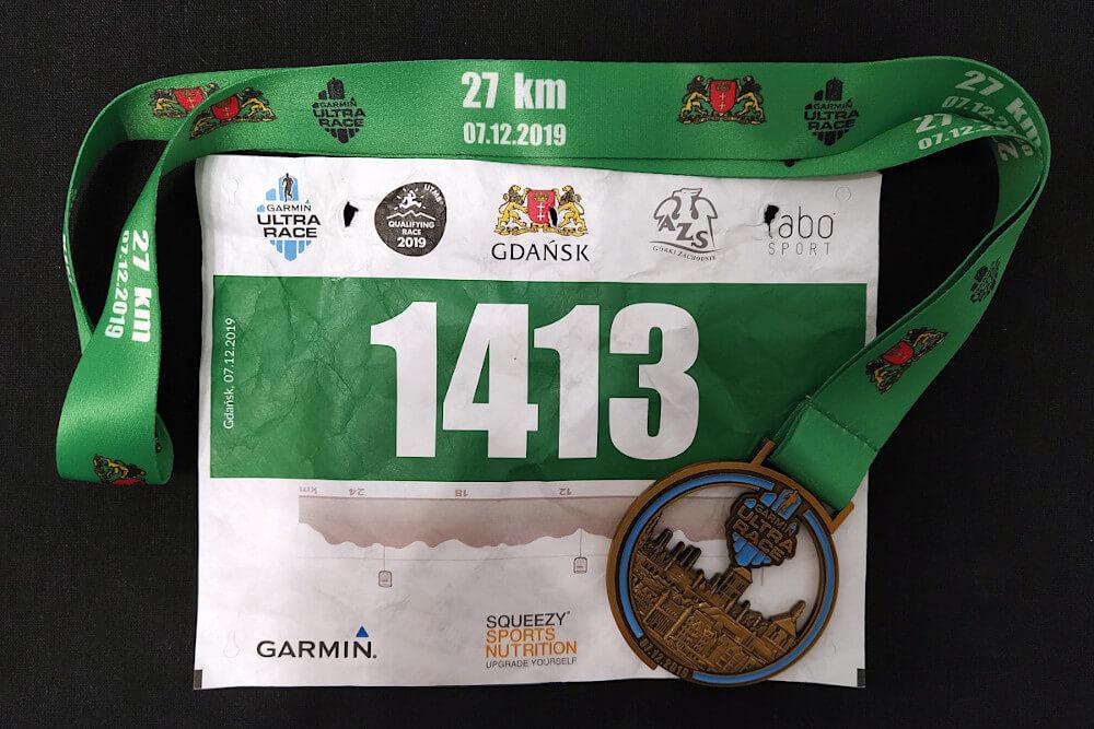 Numer startowy i medal ukończenia Garmin Ultra Race